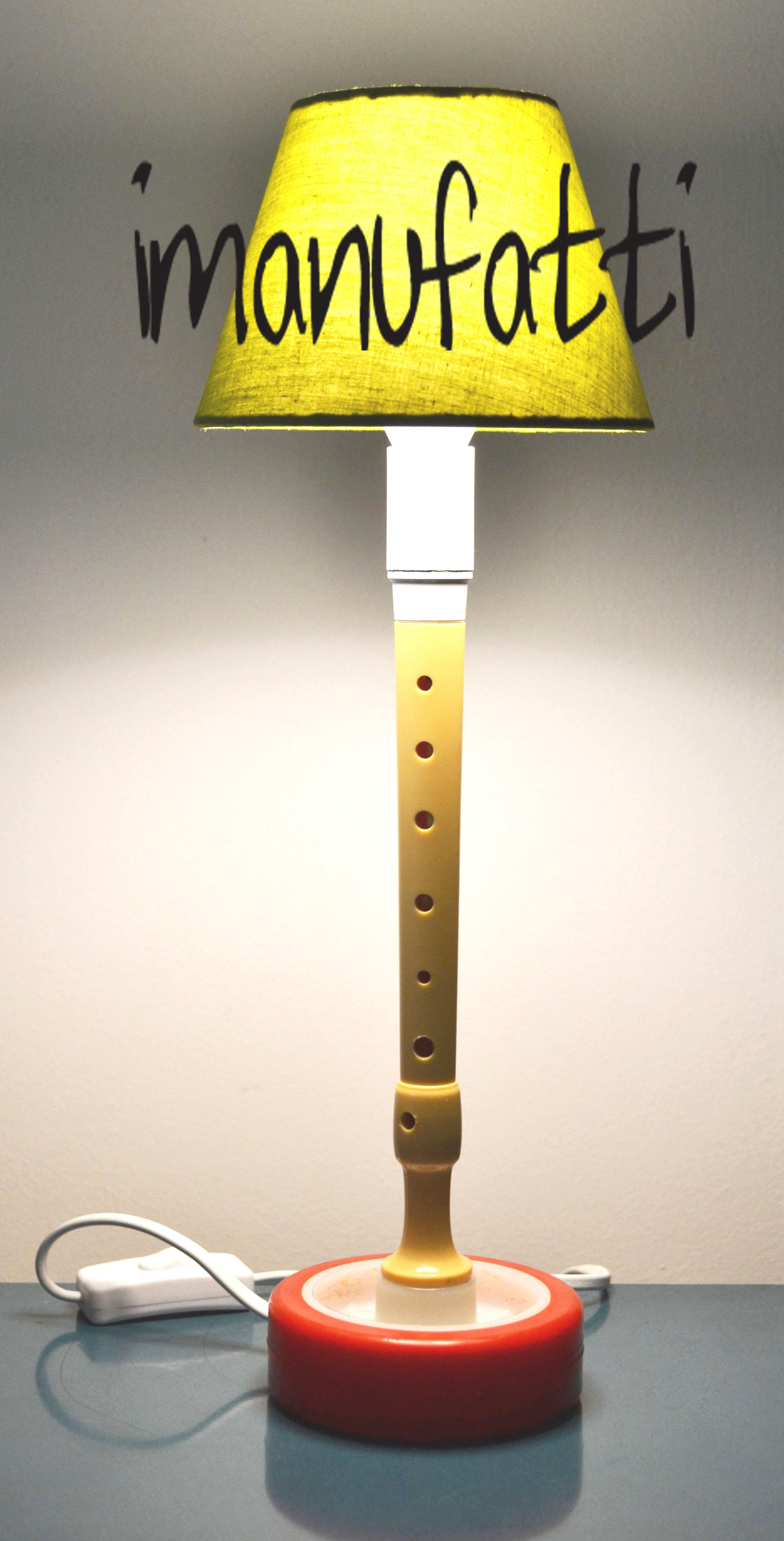 Lampada con ruota e flauto